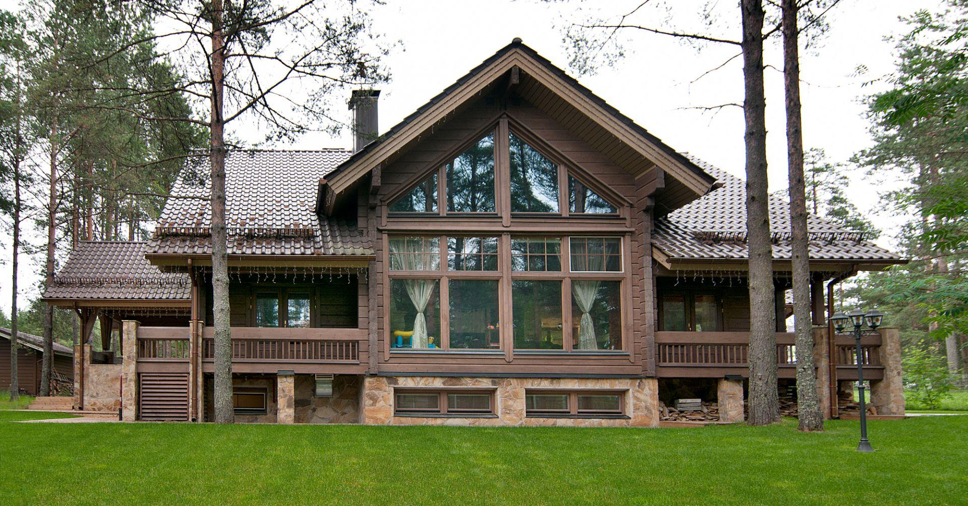 Проект красивой трёхэтажной финской виллы Karhu из клееного бруса