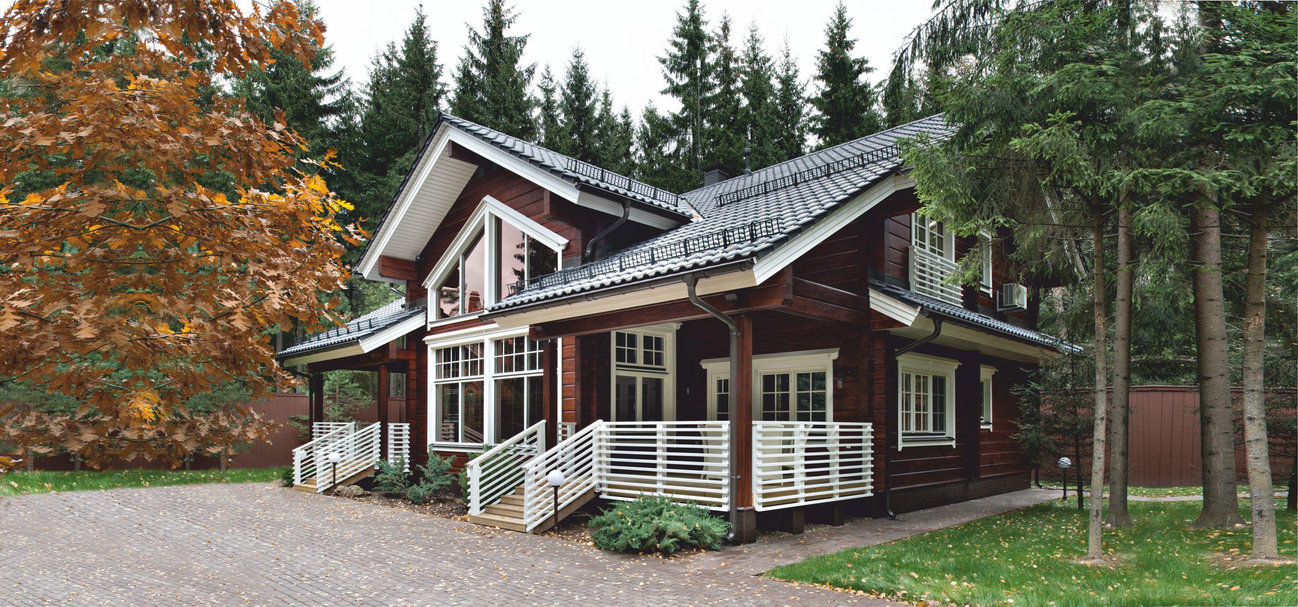 Красивый проект финского дома из клееного бруса. Granit от HONKA