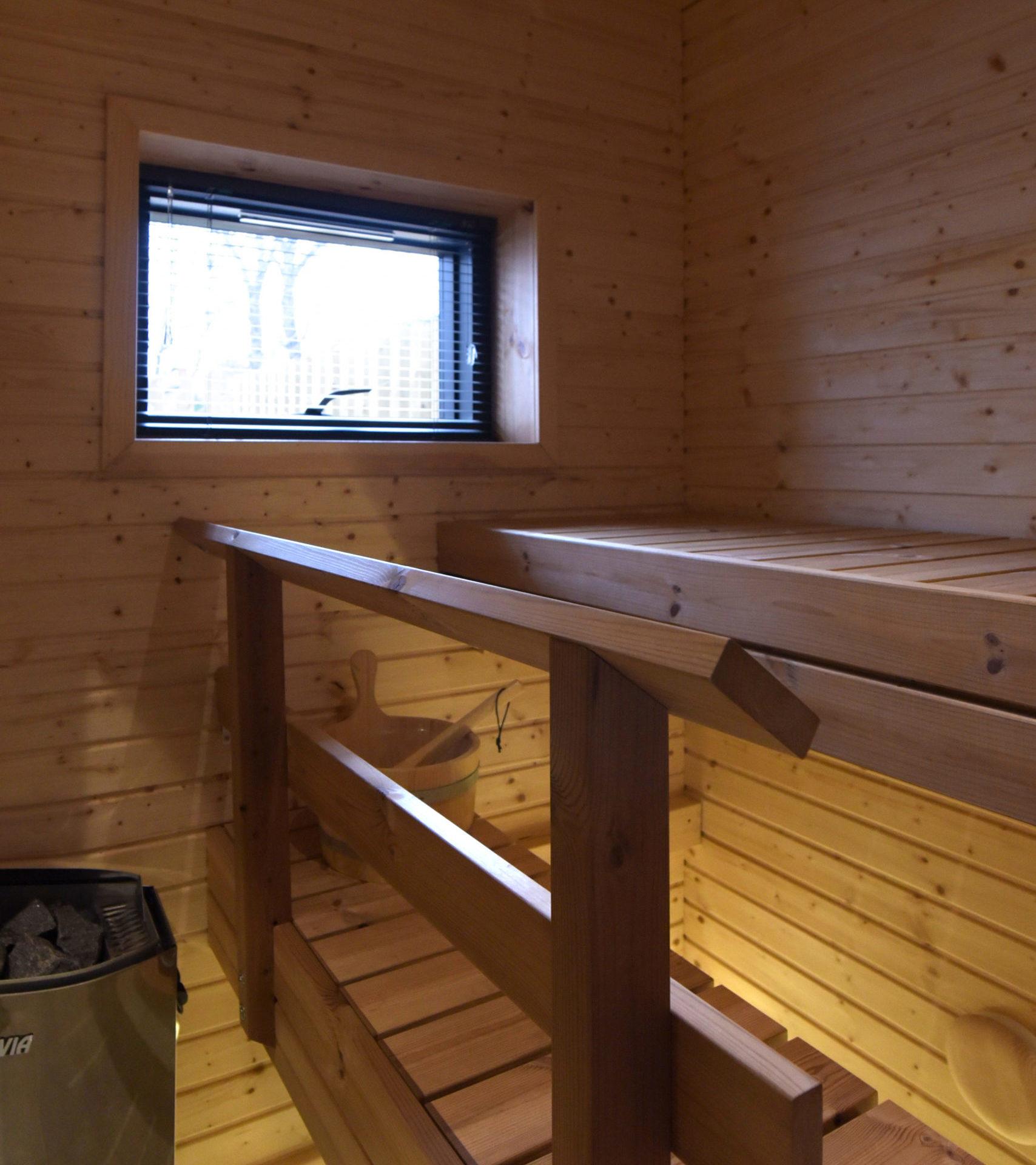 ультрасовременный проект дома с сауной из клееного бруса